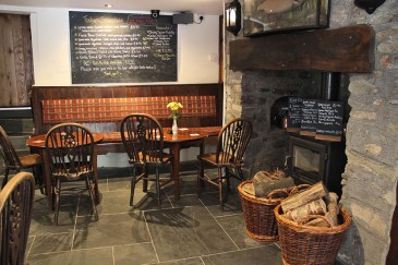 trout-n-tipple-pub-seating-fireplace